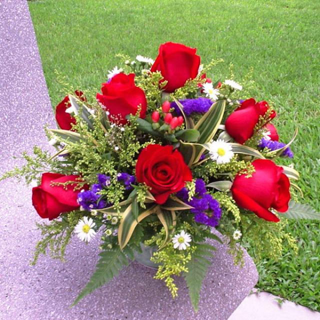 12 Red Roses all round arrangement.