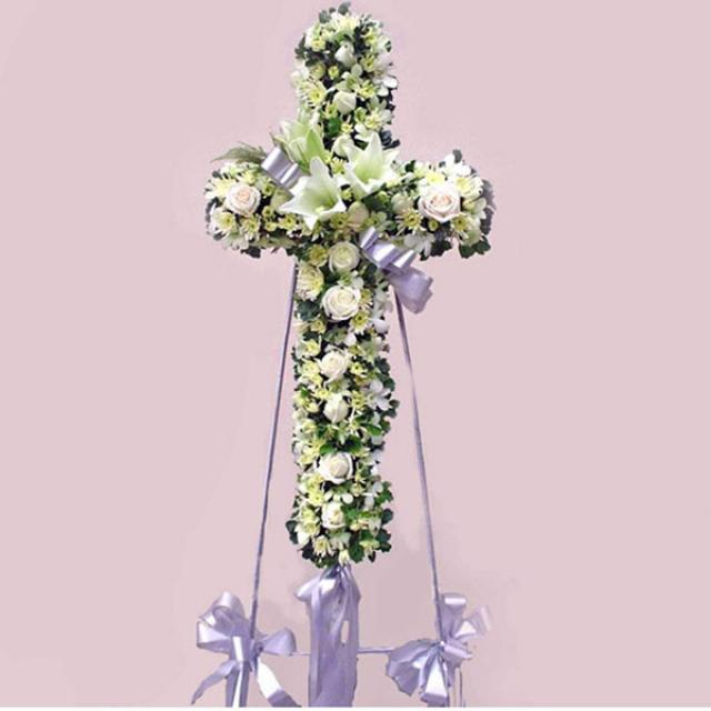 White Roses, Lily and Pompom in cross metal stand.