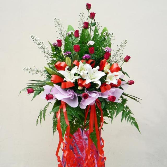Lily White & Red Roses in metal stand 6 feet height.