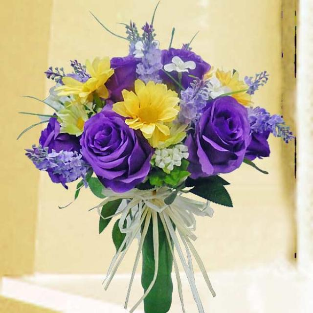 purple artificial roses hand bouquet