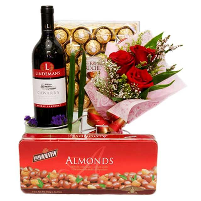 chocolate mixed with Red Wine from Australia and 3 red Roses bou