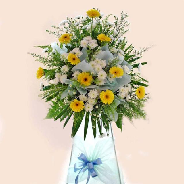 Yellow gerbera arrangement 5' height.