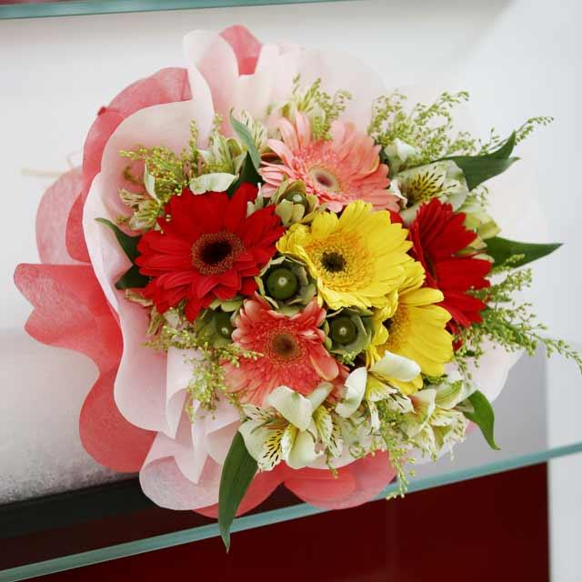 6 Mixed Gerbera hand bouquet