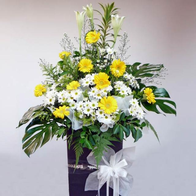 Lily white & yellow gerbera on standing box 5' height