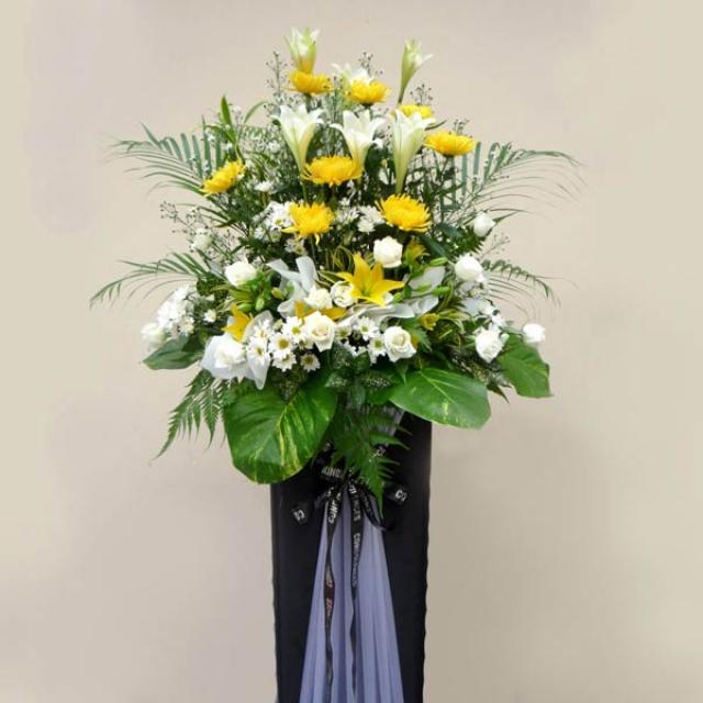 White Lily, Chrysanthemum yellow & White roses arrangement on Box stand 5' height