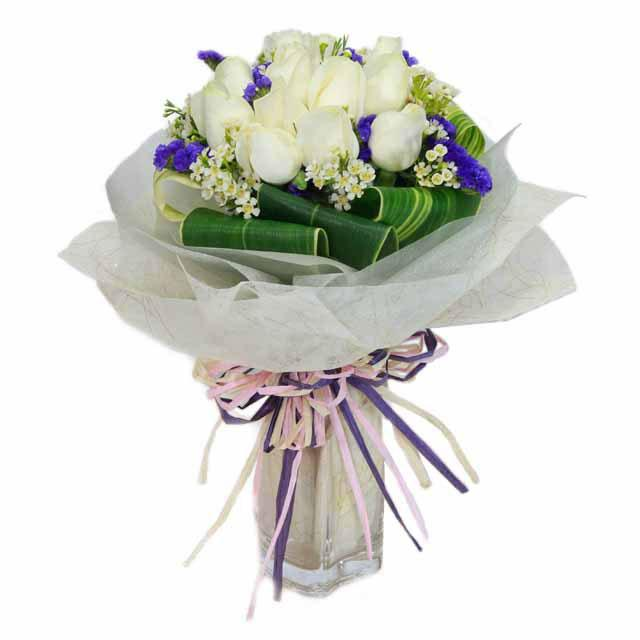 12 white roses with cordyline foliage bouquet