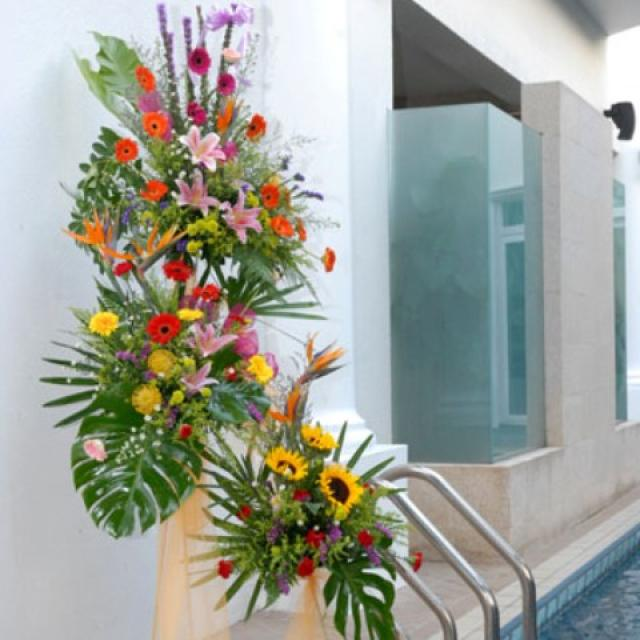 Sun flower, Pink Lily & Mix Gerbera 3 tiers metal stand arrangement.