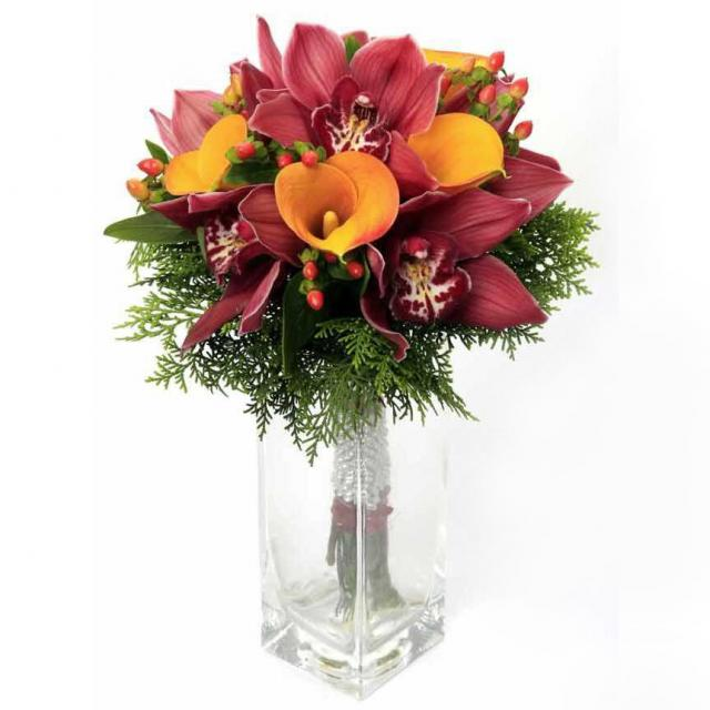 Golden Cala lily with Fresh cut red Cymbidium Orchid ,Hypericum and Coniferen foliage hand bouquet.