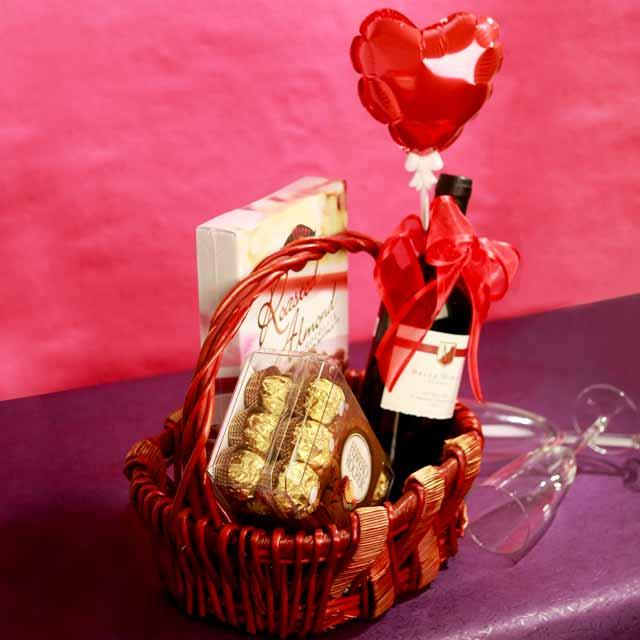 Red wine with 2 Exotic Chocolate and Heart shape balloon in Basket