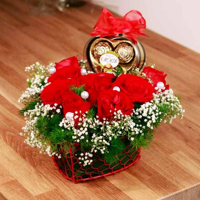 9 red roses arranged in Heart shape Basket with 3 chocolate in heart shape Box