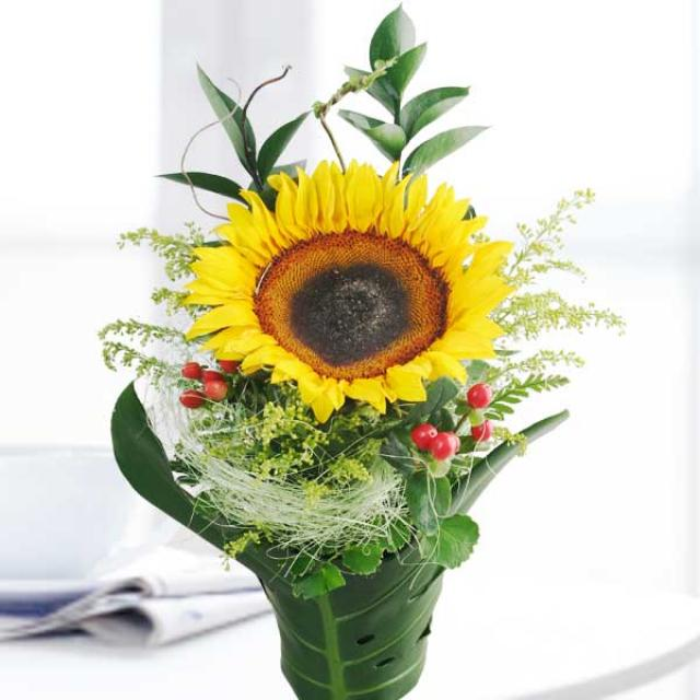Sunflower with monstera foliage special small table arrangement