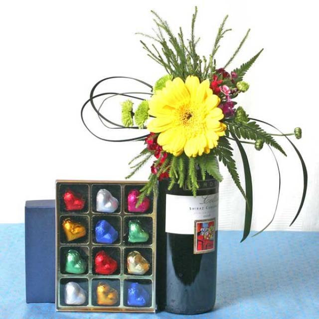 Red Wine decorated with Flowers & Cocolates