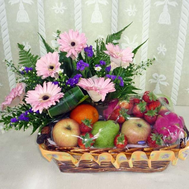 Mixed Fruits and Pink Gerberas Arrangement