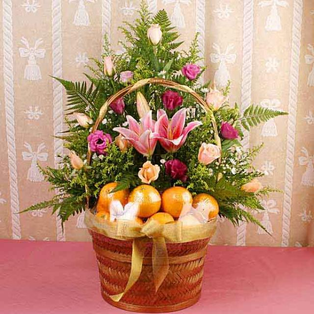10 Oranges with Pink Lilies & Champagne Roses Basket Arrangement