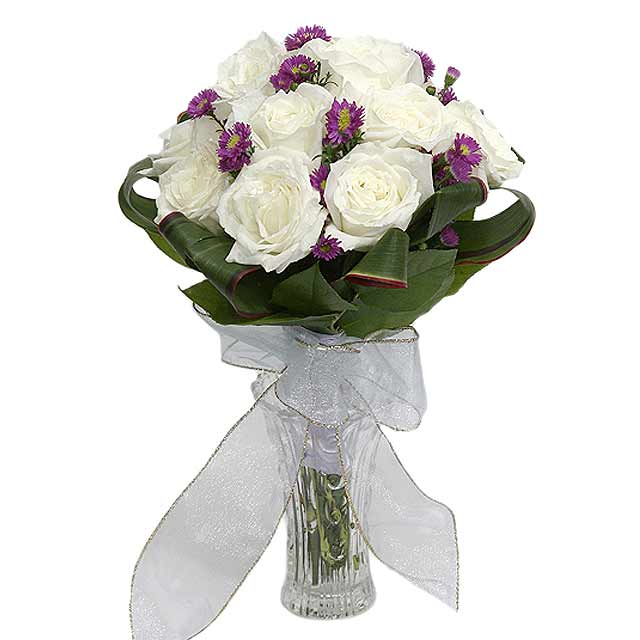 12 White Roses Wrapped with Cordyline Foliage