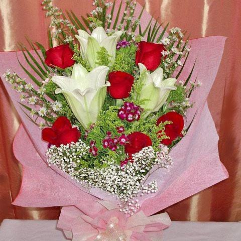 3 Lily 6 Red Roses hand bouquet.