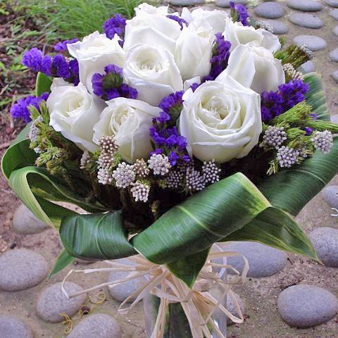 12 White Roses with cordyline foliage Hand bouquet