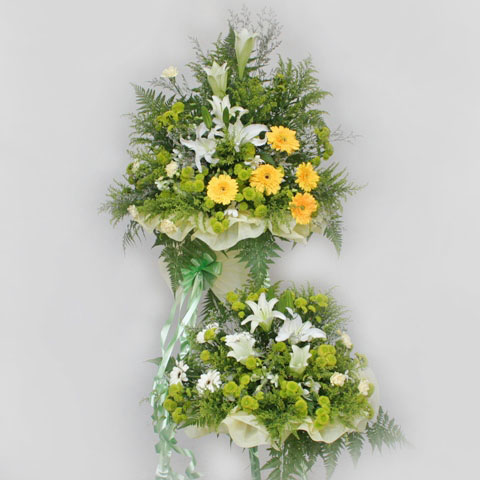White Lily and Yellow Gerbera Arranged in metal stand 6' height