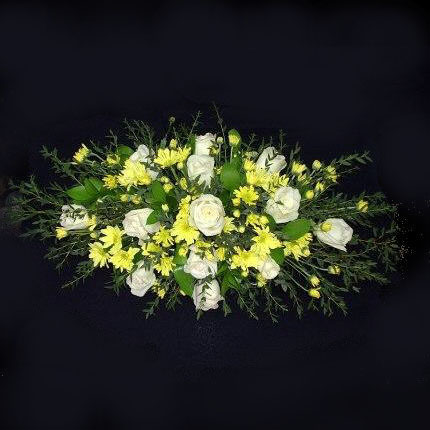Casket Spray with white Roses & mixed flowers.