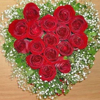 Red Roses heart shape table arrangement.