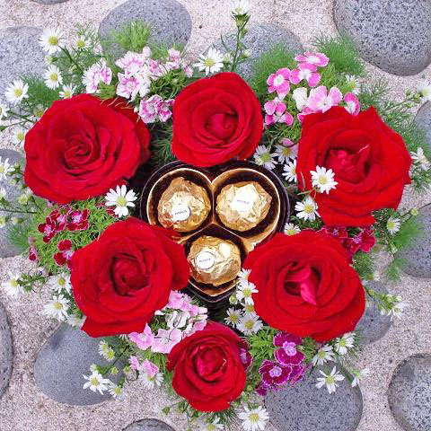 Red Roses Heart-Shape table arrangement with 3 chocolate