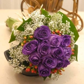 12 Purple Roses with baby breath wrap with monstera foliage