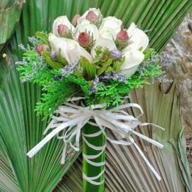 12 white roses with Leucadendron and Pine foliage wrap with dracaena Leave