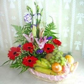 Red Gerbera with Pink Lily and Fruits Basket arrangement