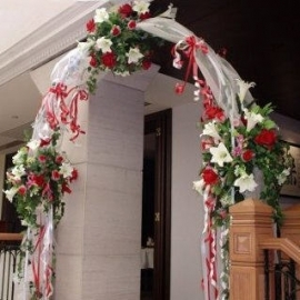 Wedding Arch Rental 1 day Decorated with Silk Flowers.